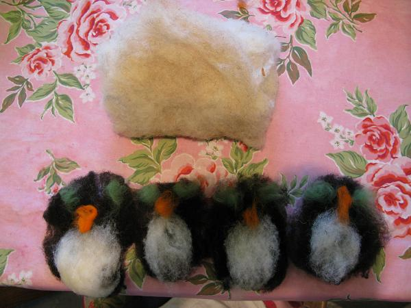 Four penguins waiting to be felted to the case.