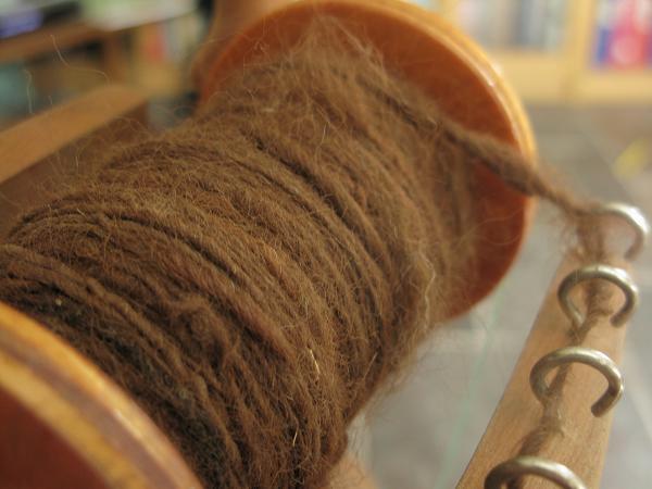 spinning brown alpaca wool