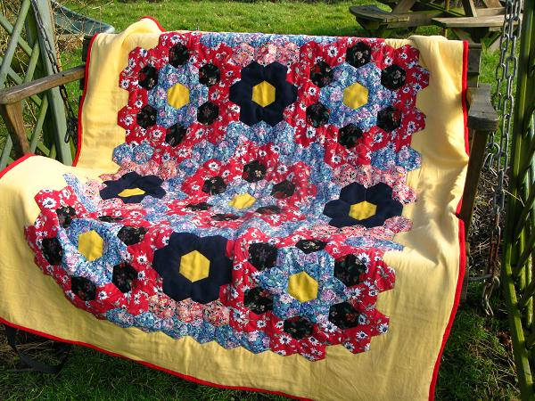 hexagon patchwork quilt on swinging bench