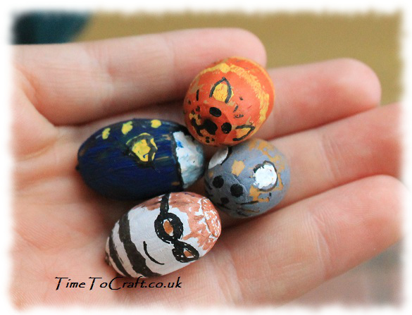 handful of painted acorn craft 2