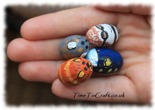 handful of painted acorn craft