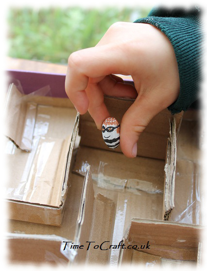 robber acorn entering cardboard maze craft