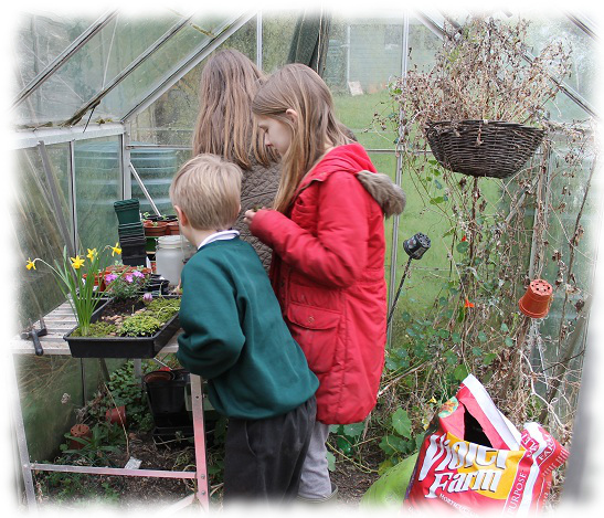 children in greenhouse
