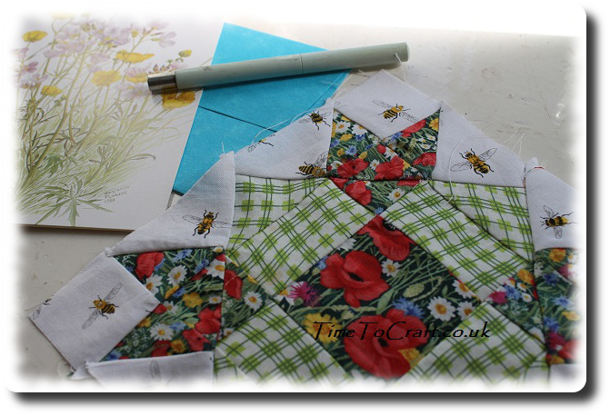 letter and quilt square