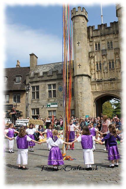holding hands around the maypole