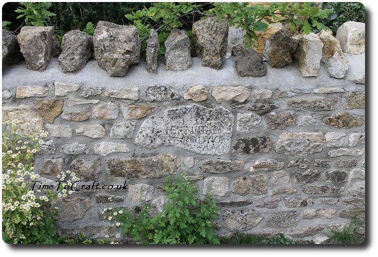 gravestone in wall