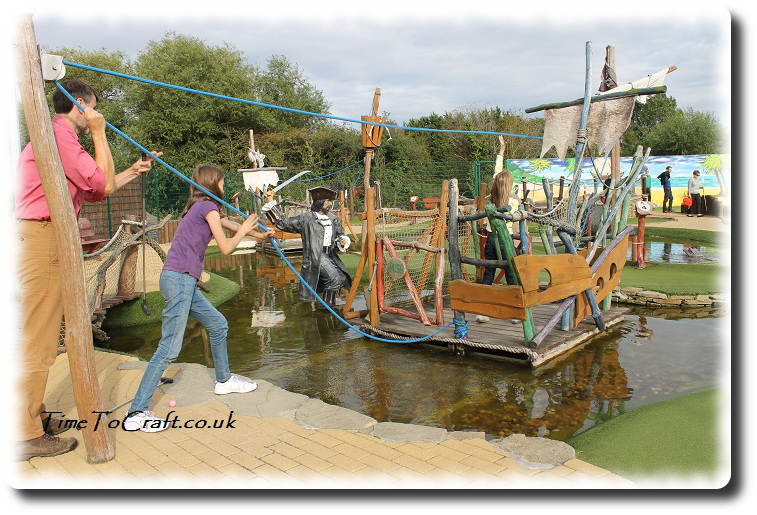 pulling boat at crazy golf group