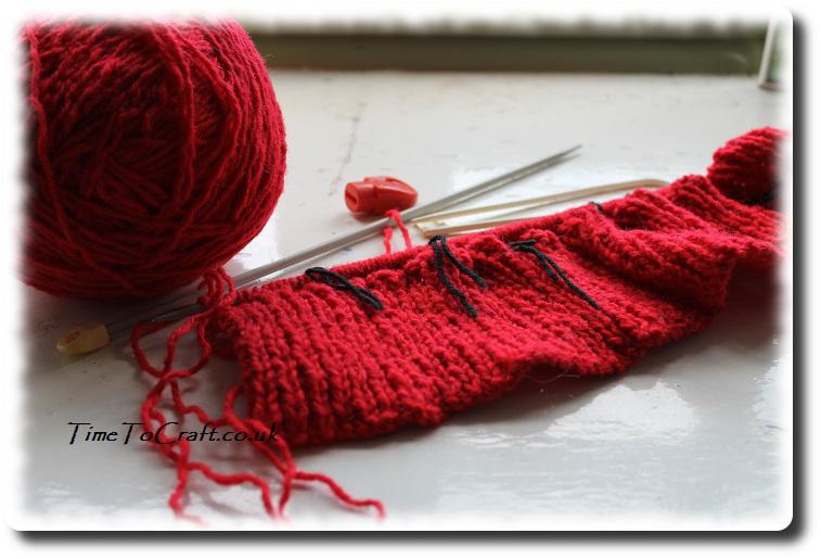 start of red aran jumper