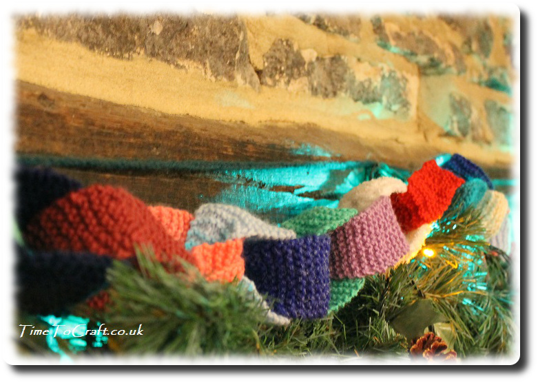 knitted paper chain above fireplace