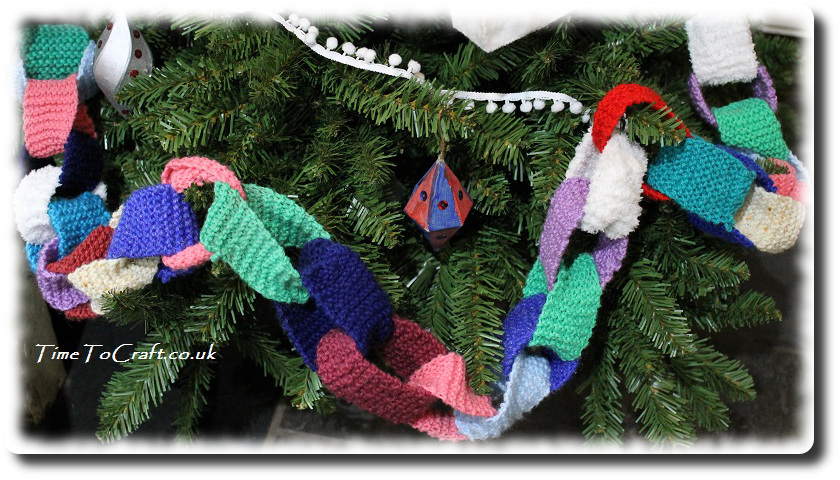knitted paper chain on tree