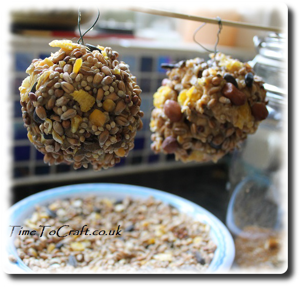 peanut and seed bird feeders using pine cone