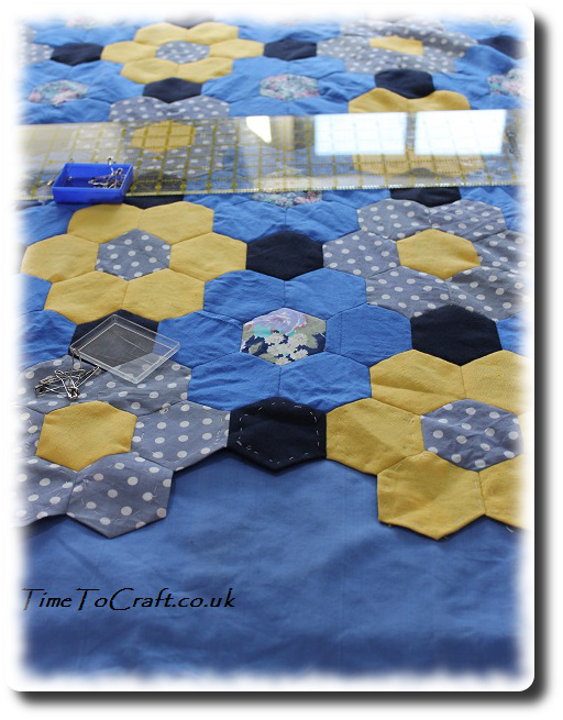 blue and yellow hexagon quilt top with surround