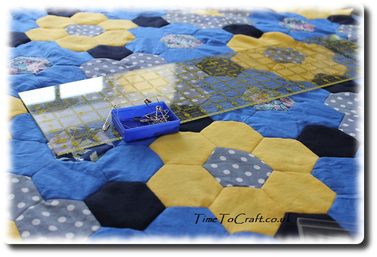 blue and yellow hexagon quilt top