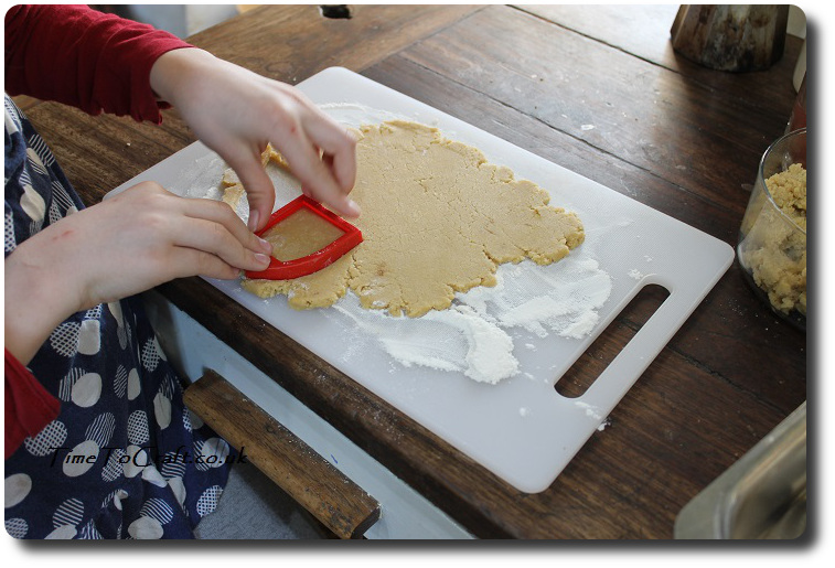 cutting out St George day biscuits