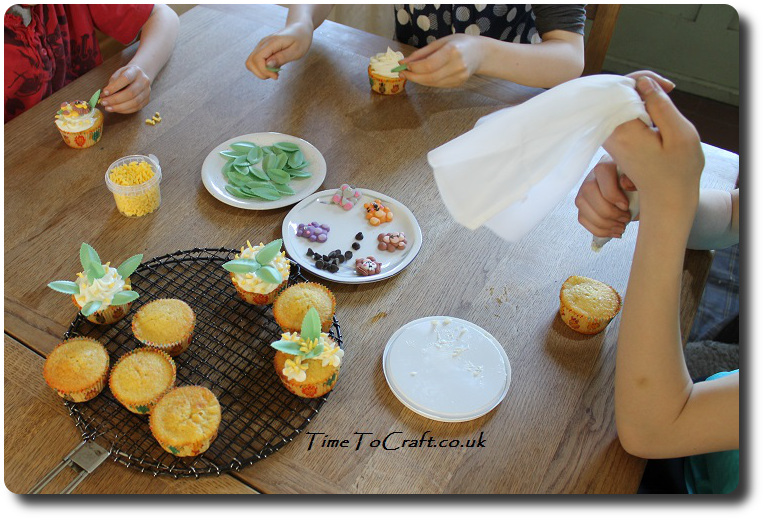 children making jungle themed cupcakes party