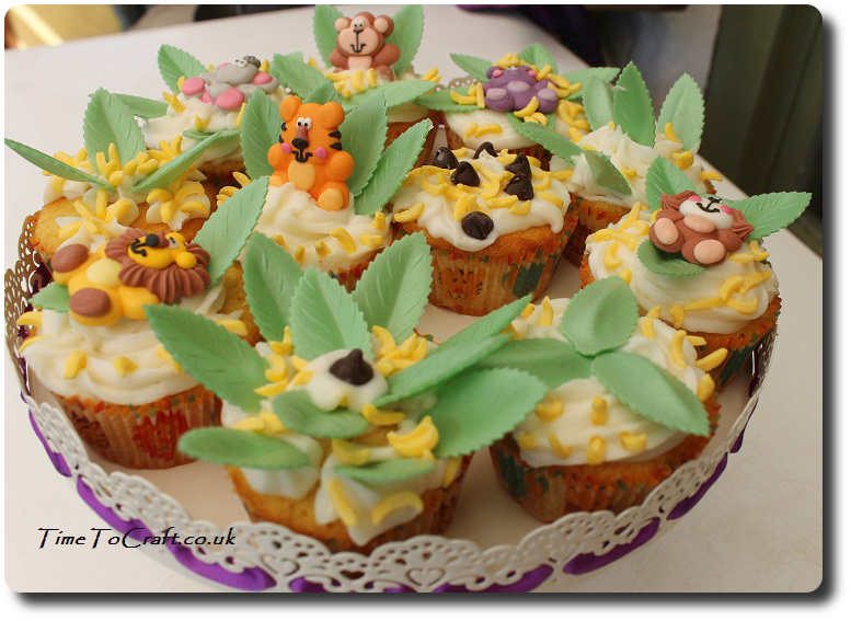 jungle animal party cupcakes on cake stand