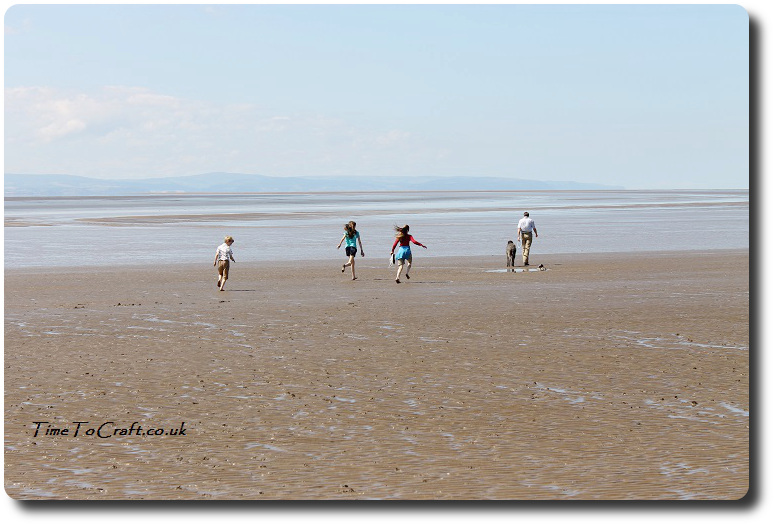 family on beach at Burnham