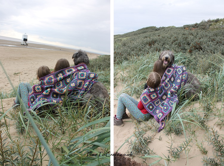 sisters and dog on the beach with crochet blanket
