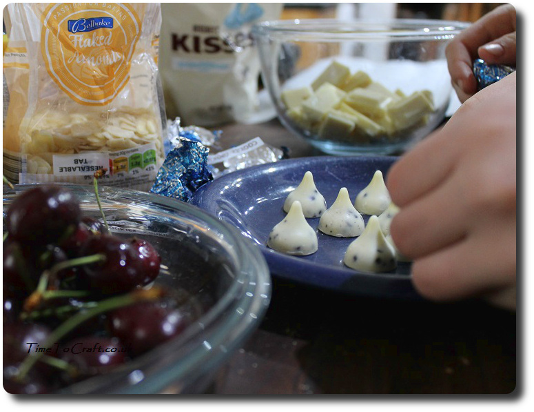 making Hershey Kiss mice with cherries and white chocolate