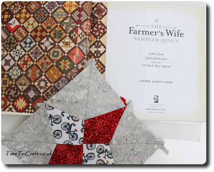 Periwinkle withThe Farmers wife letters book open