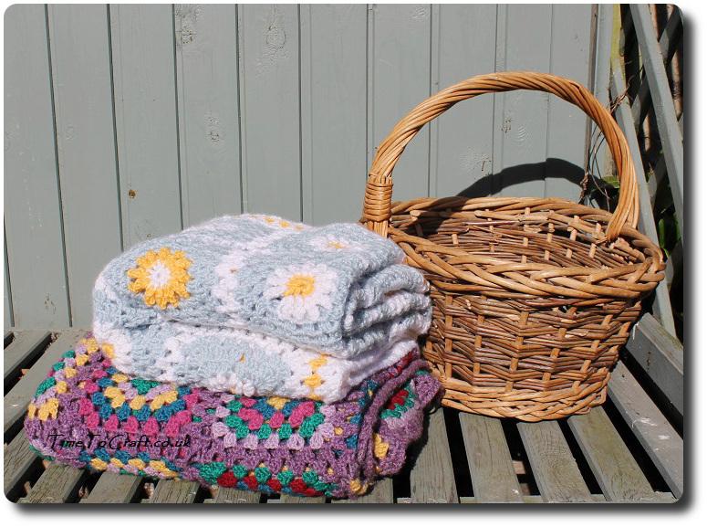 crochet daisy granny square blanket blue beside basket