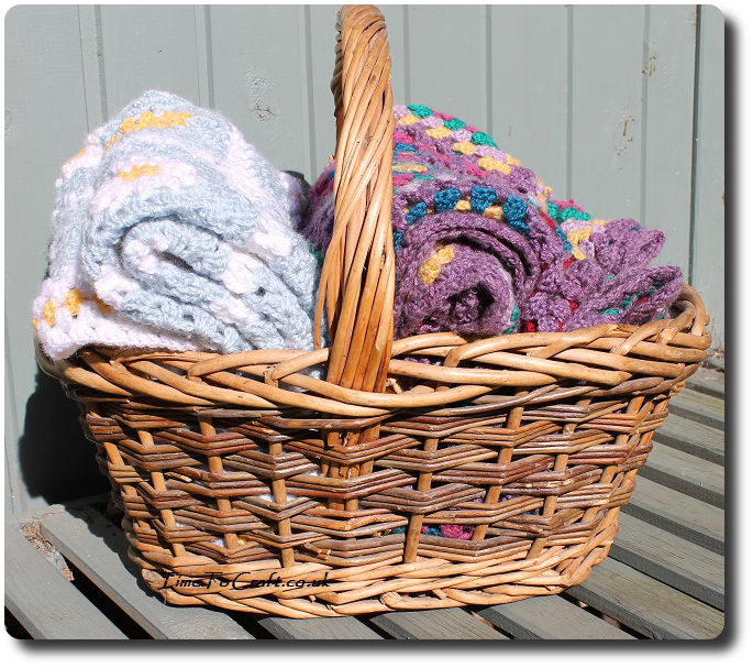 crochet daisy granny square blanket blue in basket