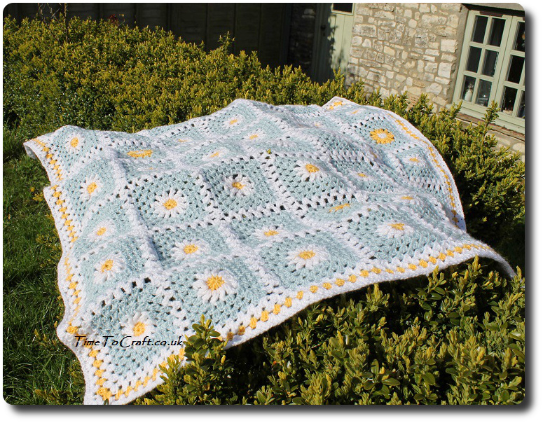 crochet daisy granny square blanket blue on box hedge