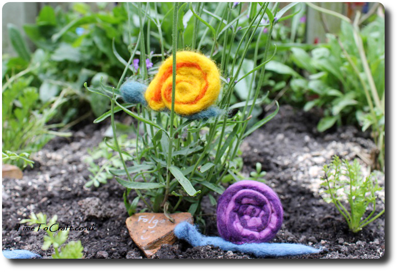 felted snails on plants kids craft activity