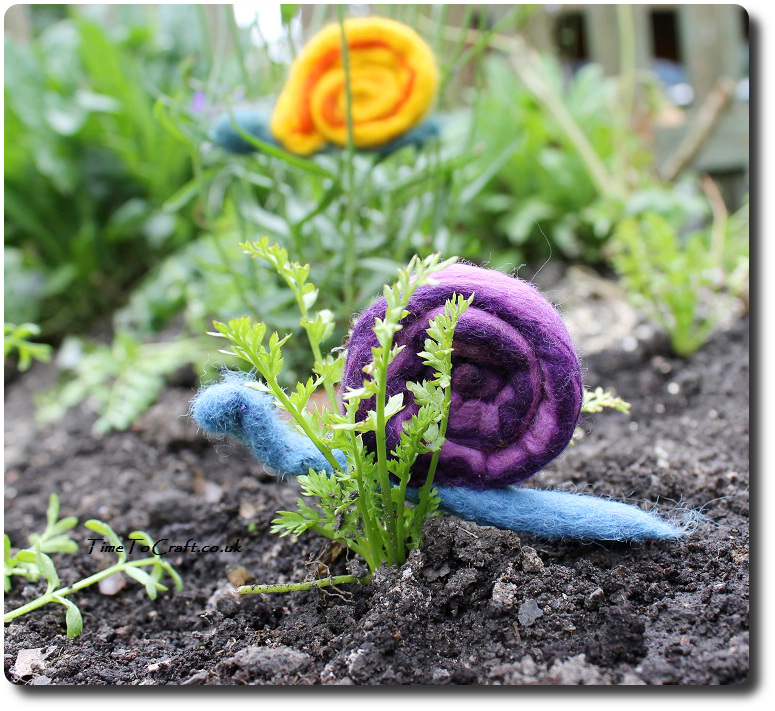 kids craft felted snail on poached egg plant