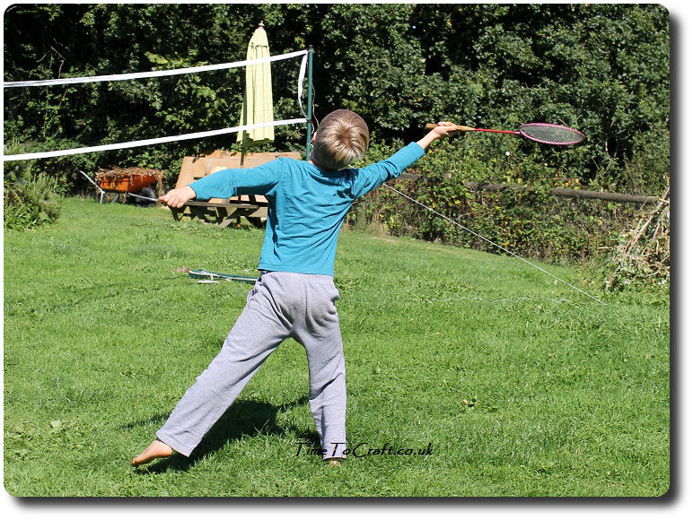 T playing badminton in the garden 2
