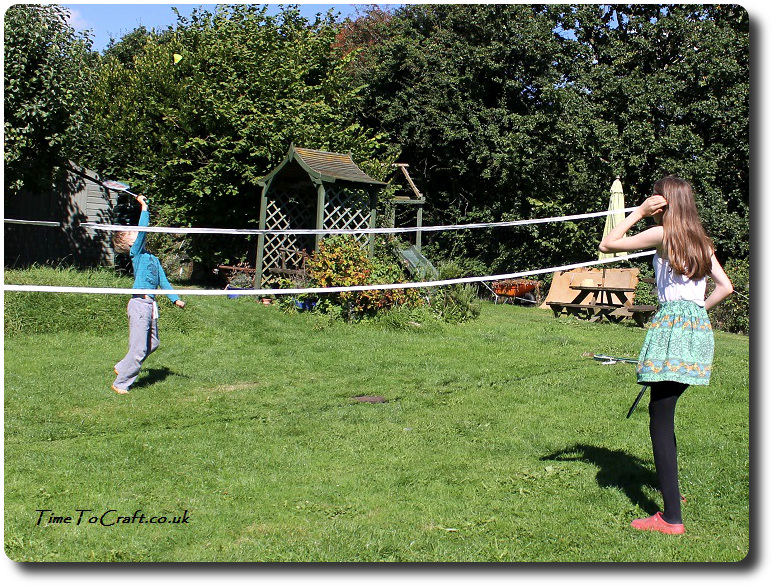 playing badminton in the garden 3