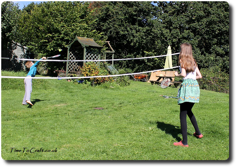 playing badminton in the garden